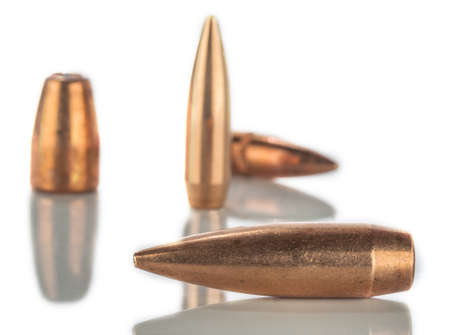 bullets on white background with reflection photo