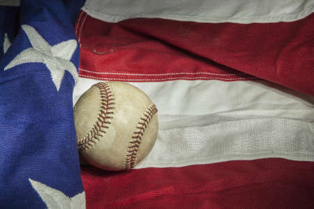major league baseball with American flag and glove photo