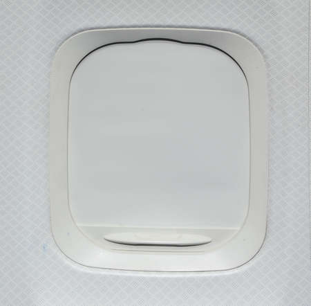 window view: Airplane window with shade down Stock Photo