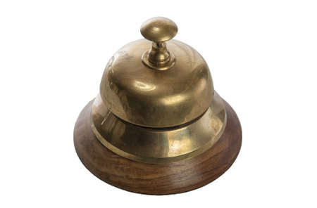 Old brass hotel bell isolated on white photo