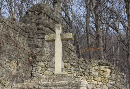 religious symbols: concrete cross on hill side