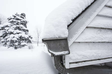 Snow drifted on roof of a home photo