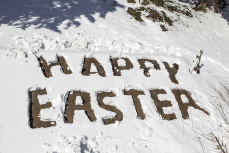 Happy easter written in snow photo
