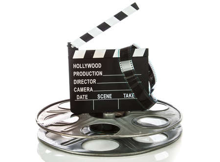 Movie Clapper Board with film reel on white background