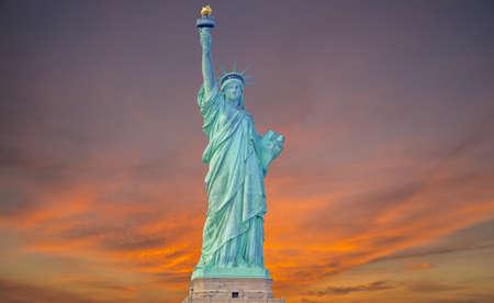 Statue of liberty at sunrise photo