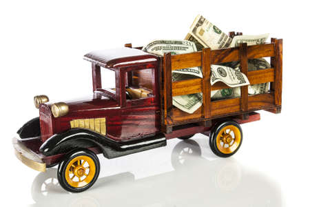 capitalism: model truck transporting money