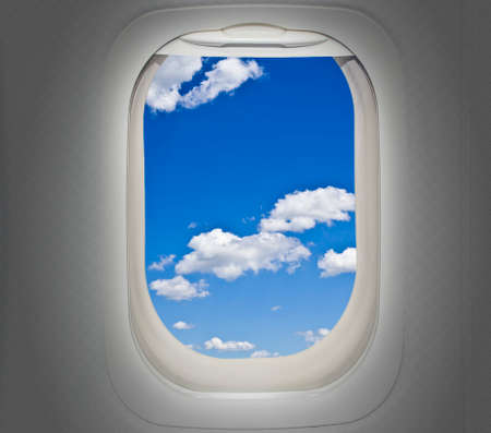 Aircraft window with clouds photo