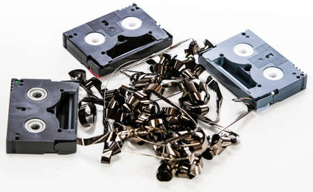 video cassette tape: Broken video tapes in a pile on white Stock Photo