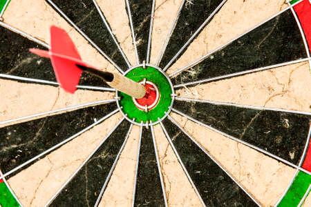 dart board: dart arrow in the target center bulls eye
