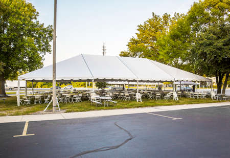 outdoor event: White banquet wedding tent or party tent