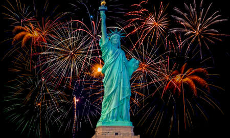 Colorful fireworks on black sky with statue of liberty photo