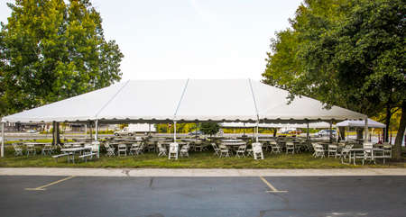 lawn party: White banquet wedding tent or party tent