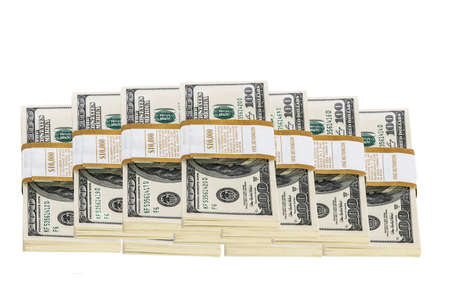 Stacks of 100 dollar bills isolated on white photo