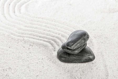 zen like: stones on sand in a Japanese ornamental or zen garden  Stock Photo