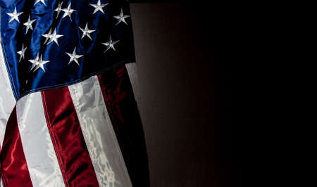 American Flag with black background for copy space Stock Photo