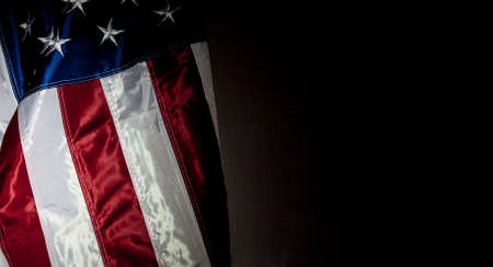 American Flag with black background for copy space Фото со стока