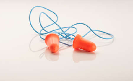 audible: A pair of hearing protection ear plugs Stock Photo