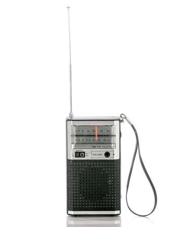Vintage era transistor radio isolated on a white background.