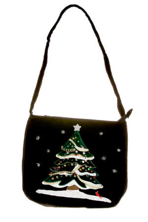 Christmas tree on purse isolated on white