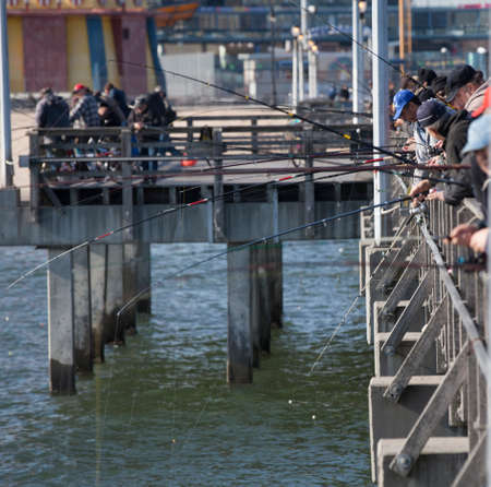 New York, Coney Island, USA - April 14, 2011: Fishermen try their luck on the Coney Island Beach Pier on April 14, 2011 in New York.