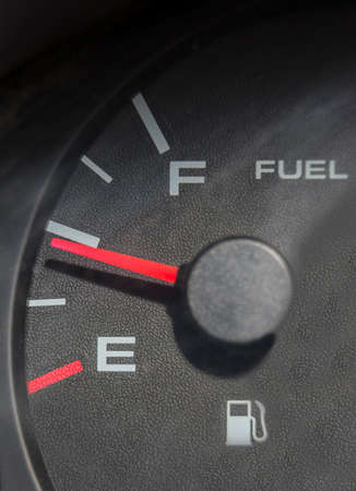 empty tank: Fuel gauge dash board close up showing half empty