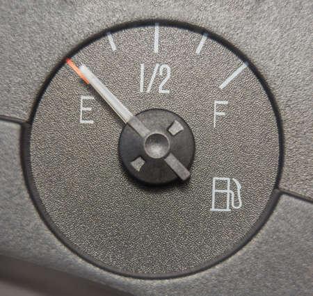 Fuel gauge dash board close up showing empty