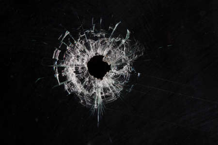 bullet holes in glass isolated on black Stock fotó - 36115157