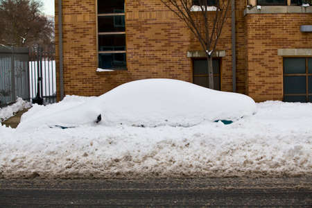 inclement: Car covered up by snow storm in NYC New York City January 2011