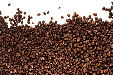 brown coffee beans over a white background photo