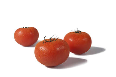 3 tomatoes, isolated over a white background Stock Photo
