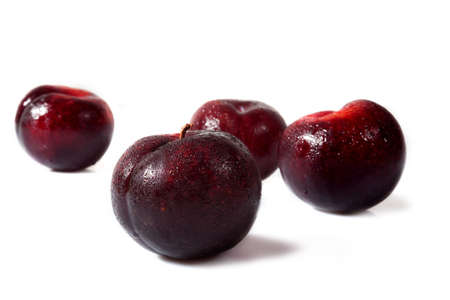 plums, isolated over a white background
