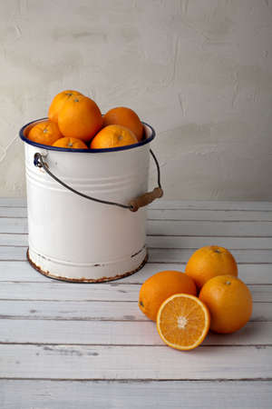 fresh oranges in an old metal bucket, country style