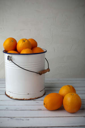 oranges in an iron bucket, country stile set
