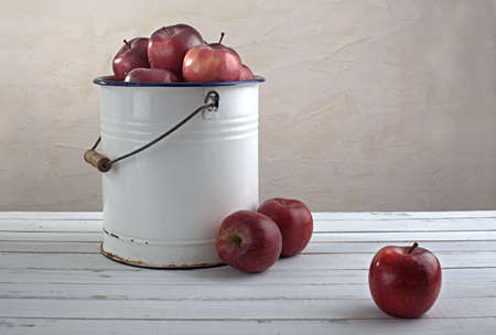 red apples in an old iron bucket Stock Photo