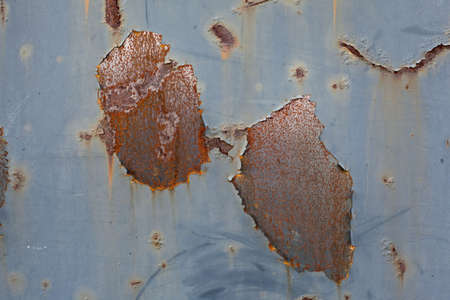 rust corrosion on a large varnished metal sheet