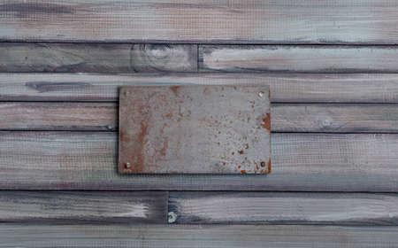 iron signboard on wood wall