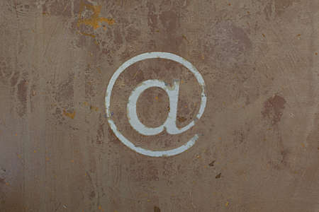 @ symbol on a rusted metal plate Stock Photo