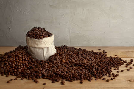 coffee beans, in a jute bag, rustic style picture, horizontal