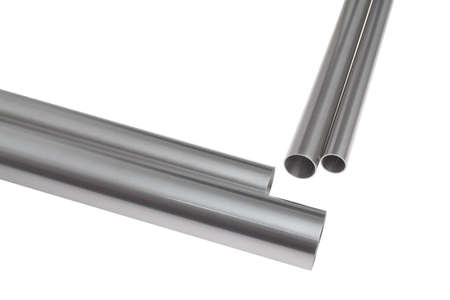 four brushed steel pipes in diagonal position, isolated over white