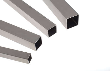 four brushed stainless steel square pipes, horizontal composition, isolated over white with copyspace, more in my portfolio. Stock Photo