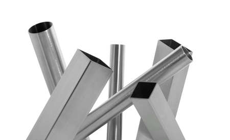 composition of stainless steel brushed pipes over white Stock Photo