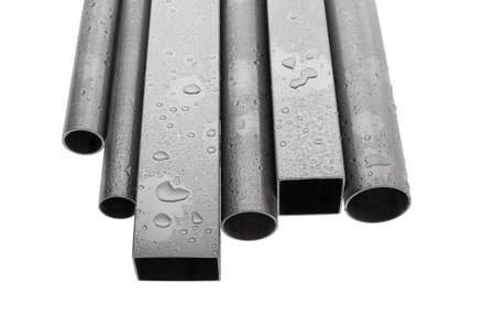 six brushed stainless steel pipes with water drops, isolated over white