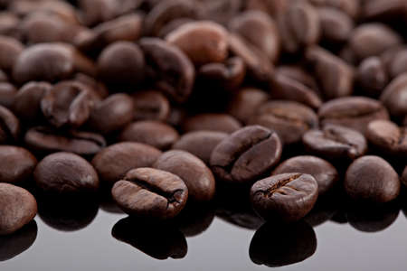 coffee beans on a black glossy surface Stock Photo