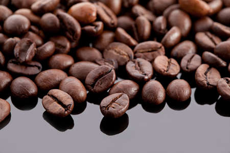 coffee beans on a black surface wit reflections Stock Photo