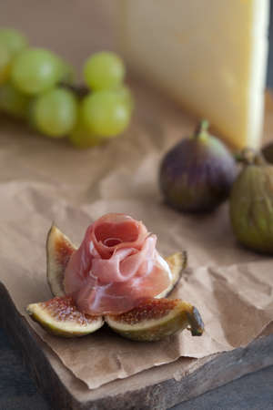 fig and lamb with grapes and cheese in the background Stock Photo