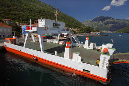 kotor: Ferry transporting cars and people in bay of Kotor, Montenegro