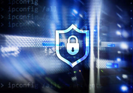 Cyber protection shield icon on server room background. Information Security and virus detection. Stock Photo
