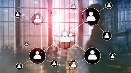 HR - Human resources management concept on blurred business center background.