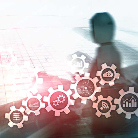 Automation technology and smart industry concept on blurred abstract background. Gears and icons.
