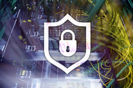 Cyber protection shield icon on server room background. Information Security and virus detection. Banco de Imagens
